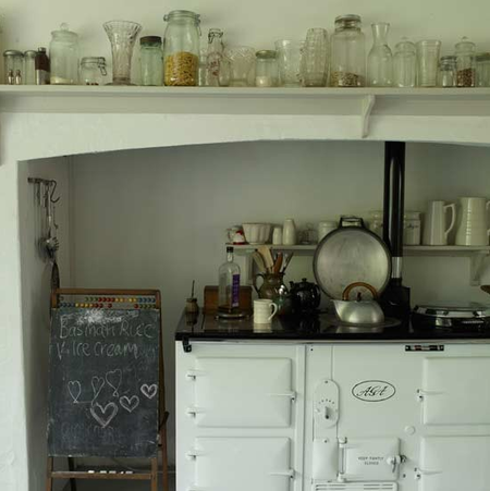 AGA Country kitchen with modern white AGA via Livingetc