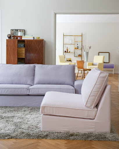 Kivik three-seater sofa in a Lavender Belgian Linen sofa cover and a Kivik one-seater in a Dusty Rose Panama Cotton cover both from Bemz