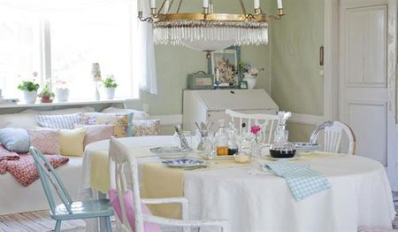 Country table in pastel-inspired room