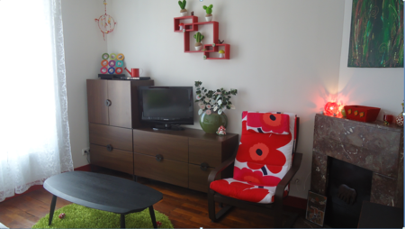 Poang chair in a Unikko Red by Marimekko from Bemz