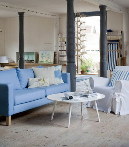 Cover for Karlstad sofa in Light Denim Blue and a Multi Fit armchair cover Tie Arm Classic in Soft White, with cushion covers in Cobalt Brera Rigato and Unbleached Belgian Linen Blend all from Bemz