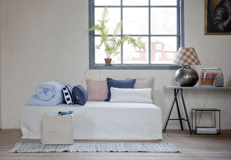 Bemz daybed cover in Soft White, with Bemz cushion covers in Deep Navy Blue Stockholm Stripe, Dark Denim Blue Piper Twill, Unbleached Belgian Linen Blend, and Soft White Panama Cotton