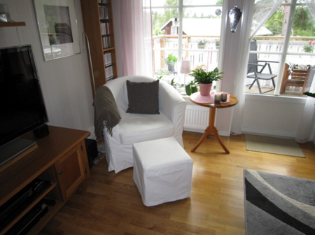 Before shot of Monica and Nisse's Tullsta armchair and Pällbo footstool