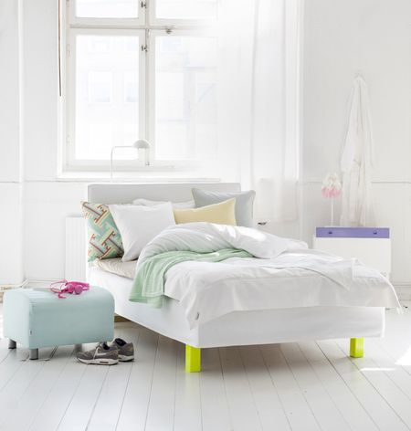Bemz bedspread in Absolute White and Bemz cover for Klippan footstool in Aqua, as well as Bemz Artist Series cushion covers