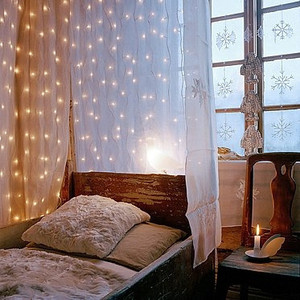 String lights in bedroom via Apartment Therapy