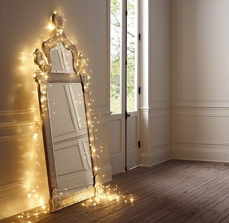 String-lights-ideas-bedroom mirror Apartment Therapy