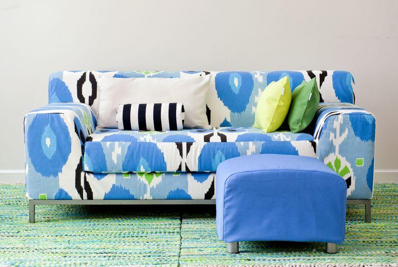 Bemz cover for Kramfors 2 seater sofa in Cobalt Espanola Way, design Designers Guild and Bemz cover for Klippan footstool in True Blue Panama Cotton