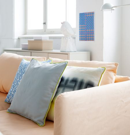 Bemz covers Söderhamn sofa in Peach Panama Cotton and Bemz Artist Series cushion covers in Silver Grey and Yellow Fiskis