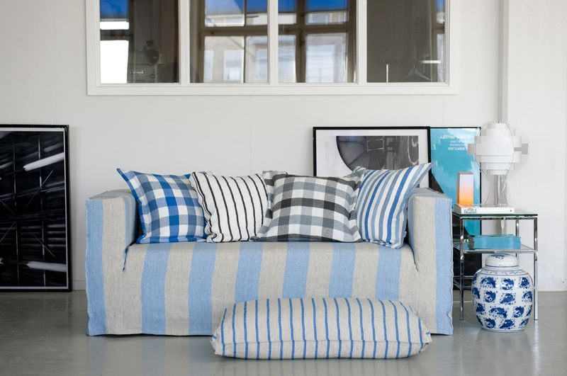 Bemz cover for Klippan sofa, Loose Fit Urban style, in Lapis Brera Largo and Bemz cushion covers in assorted Designers Guild fabrics