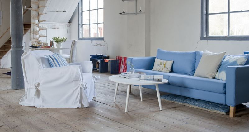 Bemz cover for Karlstad sof in Light Denim Blue Belgian Linen Blend and Bemz cushion covers in Unbleached Belgian Linen Blend