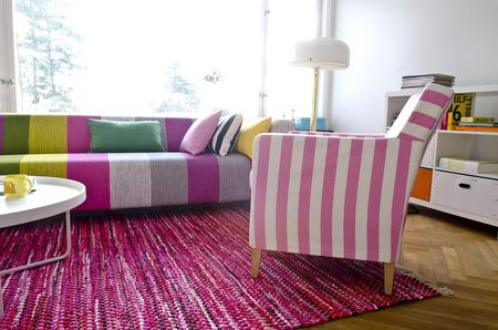 Bemz cover for Klippan sofa in Magenta Bayshore, design Designers Guild and Bemz cover for Karlstad armchair in Candy Pink&Absolute White Stockholm Stripe
