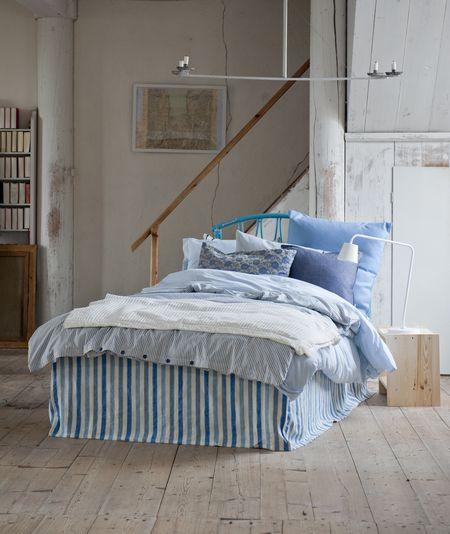 Bemz bed skirt straight, in Cobalt Brera Rigato, by Designers Guild, and Bemz cushion covers in Light Denim Blue Belgian Linen Blend and Dark Denim Blue Piper Twill