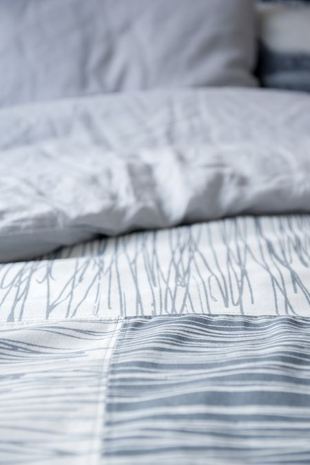 Close up of Katarina Wiklund's made-to-order bedspread and cushions